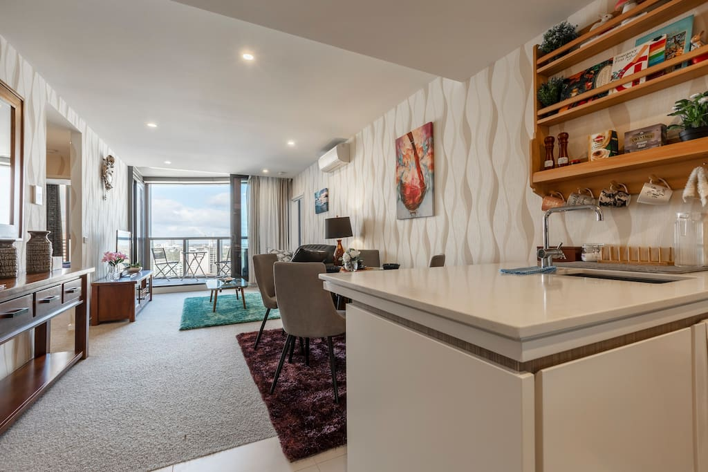 Brand new, sub-penthouse level apartment with luxurious interior design, high-end configuration, brand new furniture , utensils and  spectacularly unobstructed views across Albert Park Lake and oceans