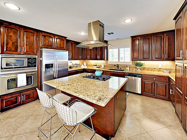 The chef in your group will appreciate the modern kitchen, outfitted with a full suite of stainless steel appliances.