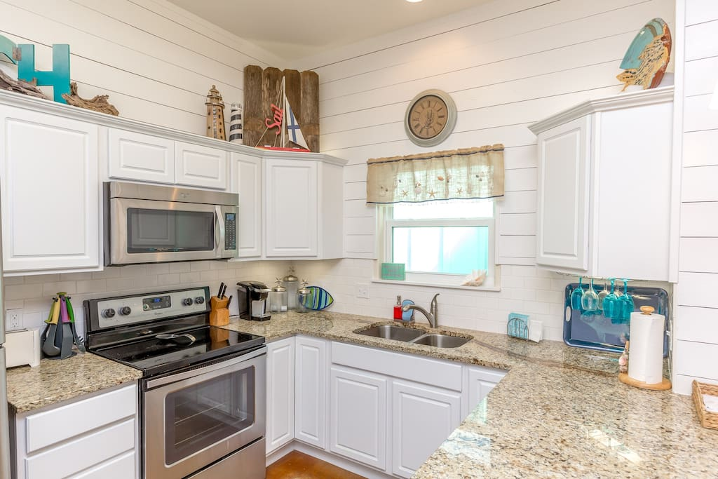 Updated kitchen with stainless appliances and lots of cookware and dishes for your vacation meals.