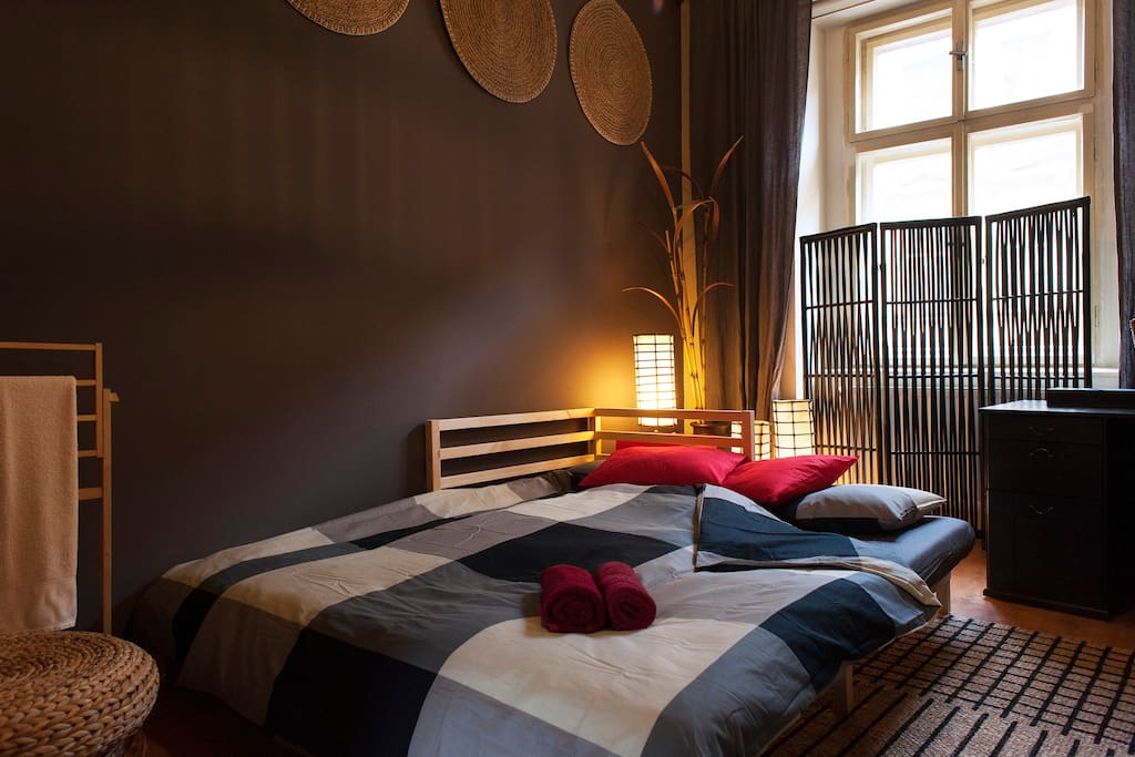 Zen bedroom with comfy bed for two.