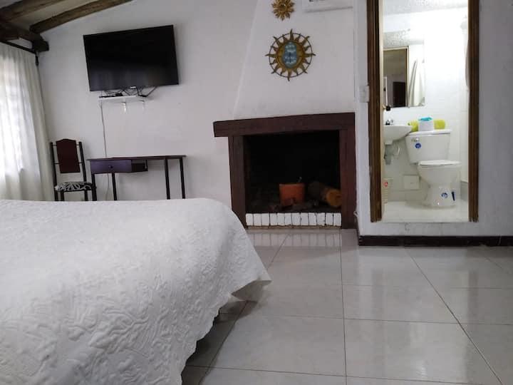 Big bedroom with fireplace. Santa Barbara