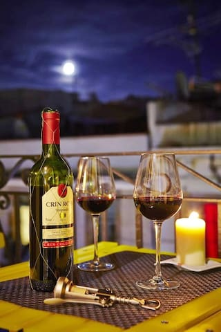 enjoy a glass of delicious local wine on your balcony and watch the sun set over Barcelona as the city comes to life down below