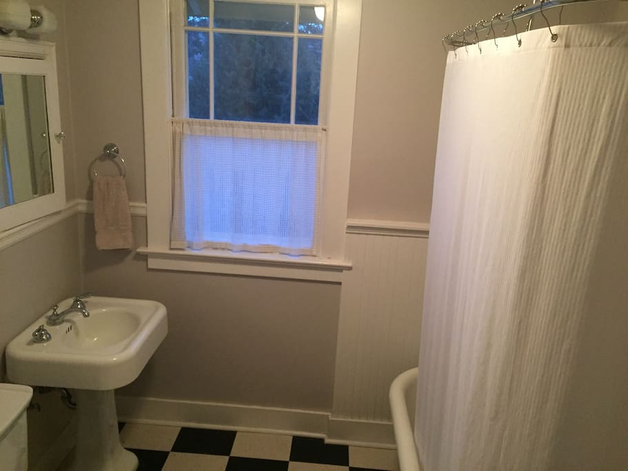 Fully renovated bath with claw-foot tub and full-height  shower
