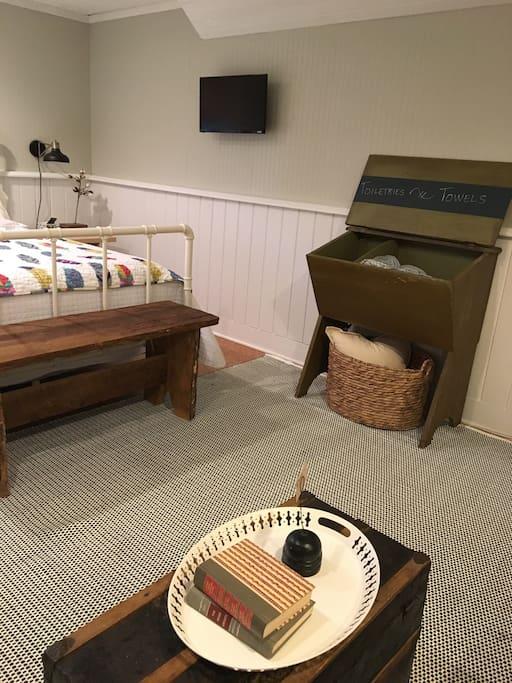 Bedroom.  Towels, toiletries, and hairdryer housed in this bin.