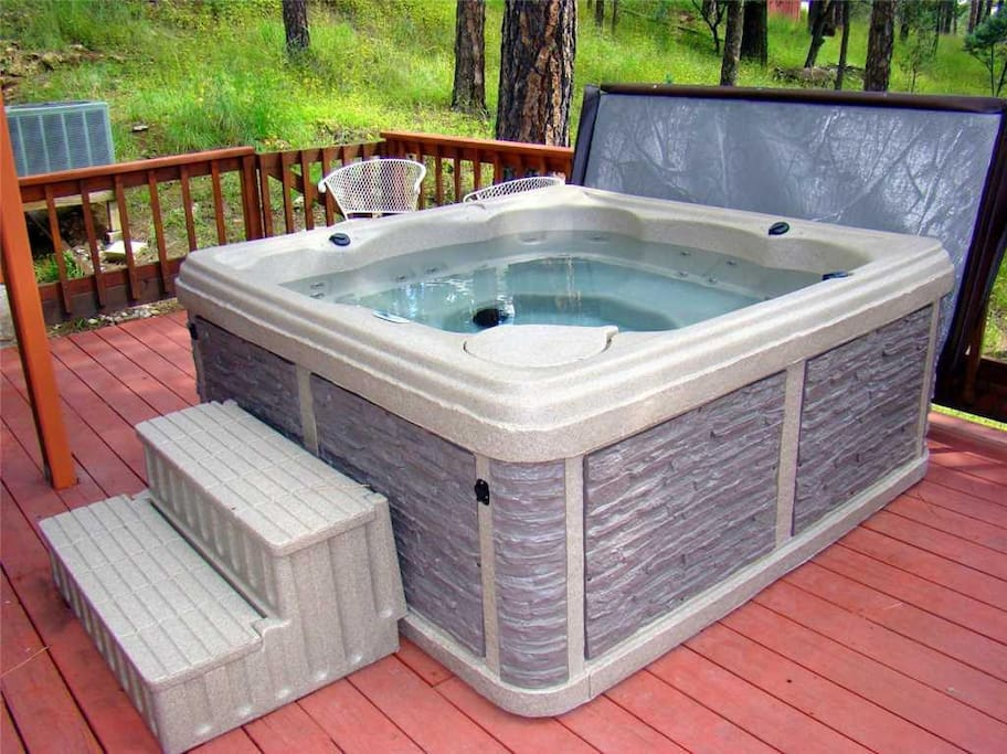 Private Hot Tub- The hot tub is ready, and you will love the privacy and convenience of having your family hideaway.