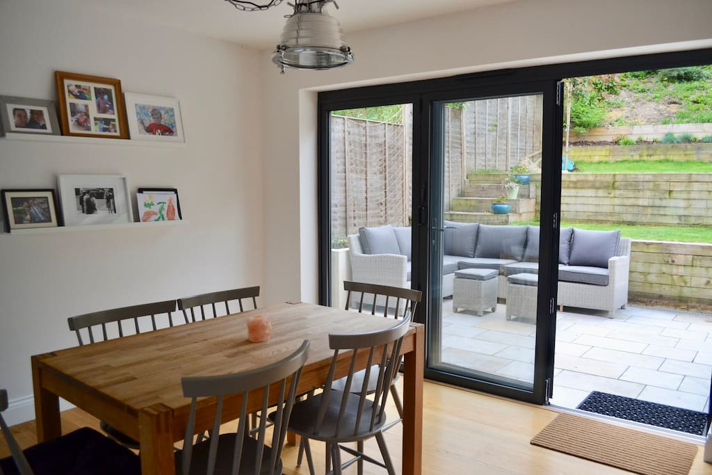 Dining area with bifold doors that open right out to patio