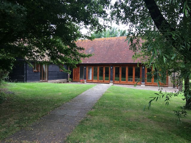 Rural Sussex barn conversion by golf course,