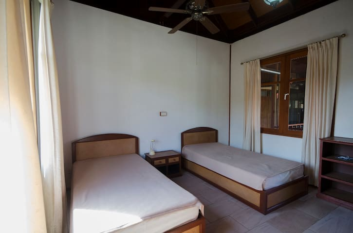 Each wing contains two separate double- bedrooms (16 sqm) situated opposite each other. The bathrooms  have modern shower cubicles.