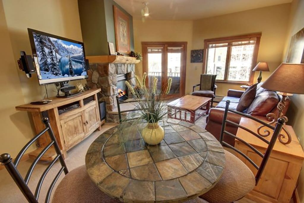 Nicely furnished ski vacation condo! Gather around this table with friends and family.
