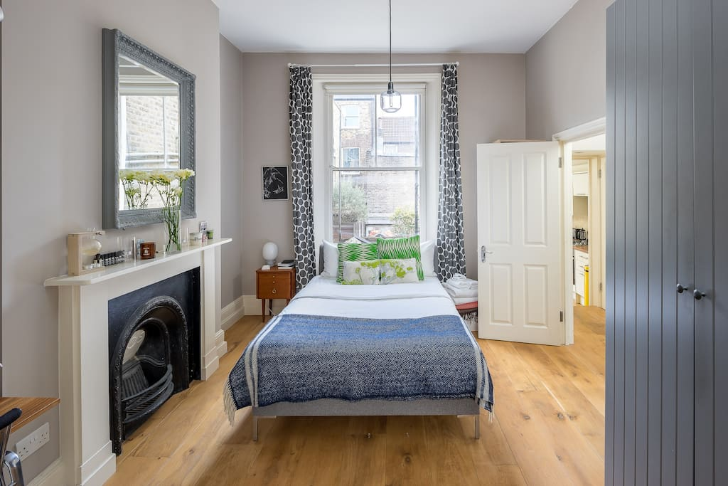 The bedroom is cosy and elegant with a comfy double bed