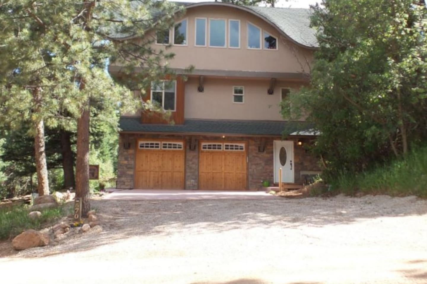 Custom built, 3 story home, 2400 sq feet in a phenomenal location backing Pike National Forest. Amenities include: fully loaded spacious kitchen, elevator access to all floors, balconys with views, and more! Driveway & garage parking available.