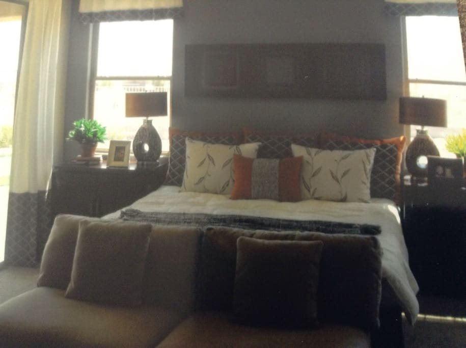 King size bed with walk in closet in bedroom