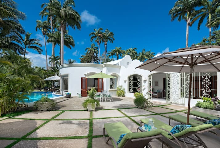 Gorgeous Villa set in a spacious courtyard style tropical setting.