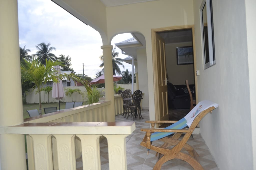Relax with a beer under the verandah in your 'fotey' (easy chair)