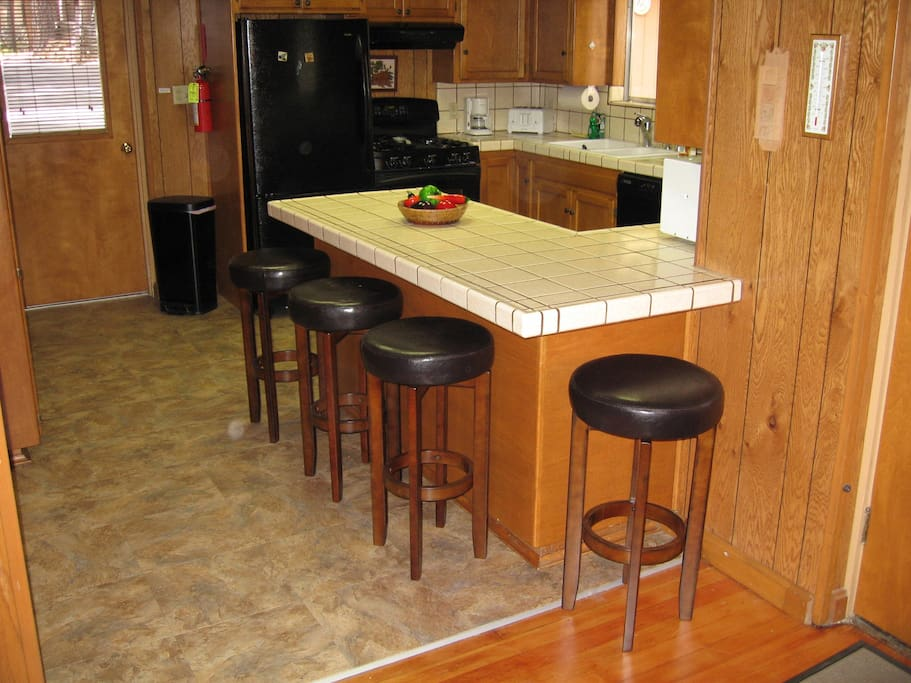 Kitchen with additional seating at bar