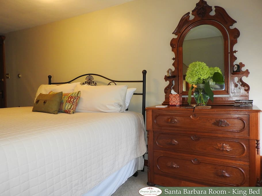 King bed and antique dresser with mirror.