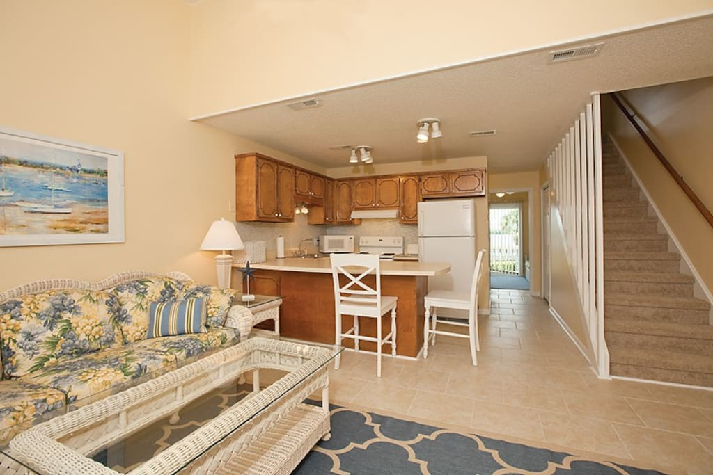 Additional photo of living area showing hallway to additional living area (overlooking pool and sound).