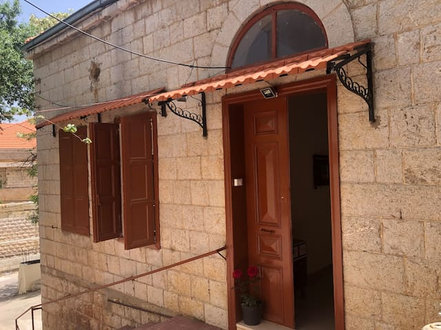 Sculptured stone rustic red tiles to add authenticity to this historical house