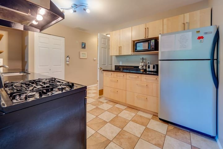 Granite counter tops, gas stove and tile floor are some of the nice kitchen features you will enjoy.