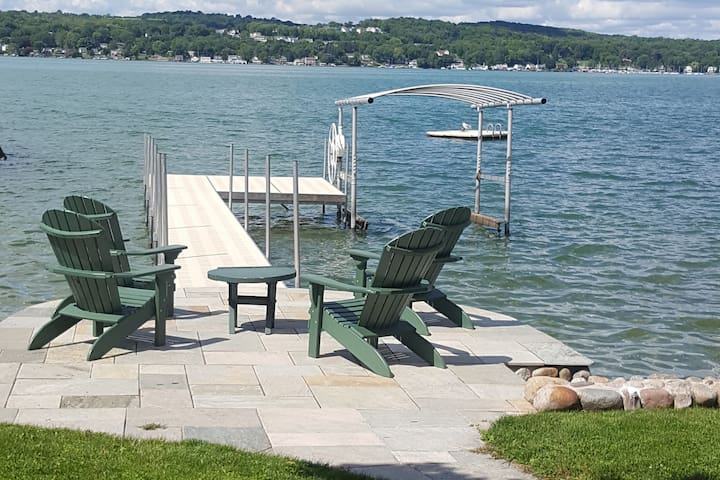 Canandaigua Lakefront home with a sunset view