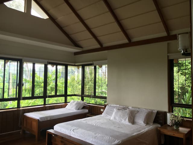 The master bedroom has a vaulted ceiling with a king-sized bed. A single bed may be added upon request.