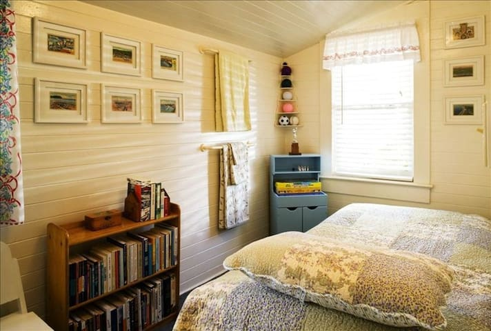 The twin bedroom has more collections, games and a book library.