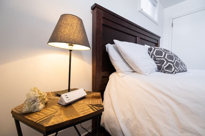 Every bedside table includes a clock with dual USB ports for easy phone and tablet charging.