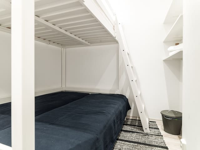 Room with four beds for up to five persons.