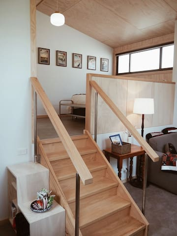 Internal stairs to upper bedroom level.