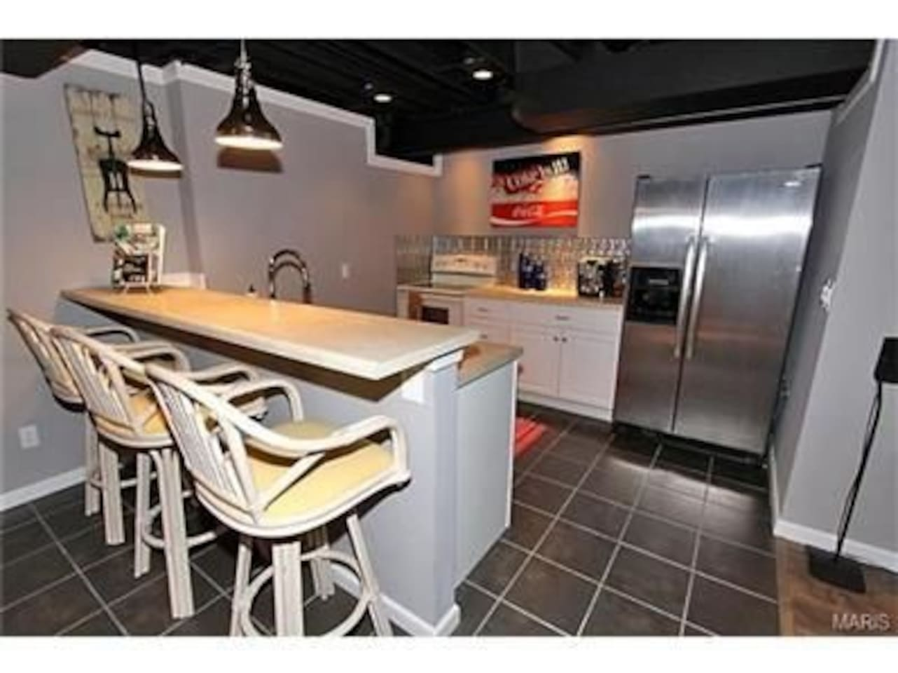 Kitchen with electric stove, Oven, Dishwasher, Microwave, Sink, Refrigerator and Cooking utensils.