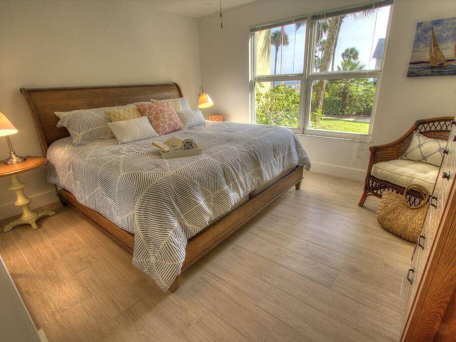 Designer master bedroom with tropical views outside