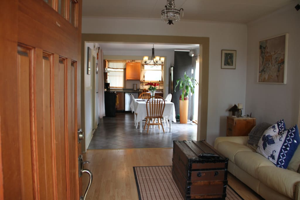 Open the Front Door and look from the Living Room to the Dining Area to the Kitchen