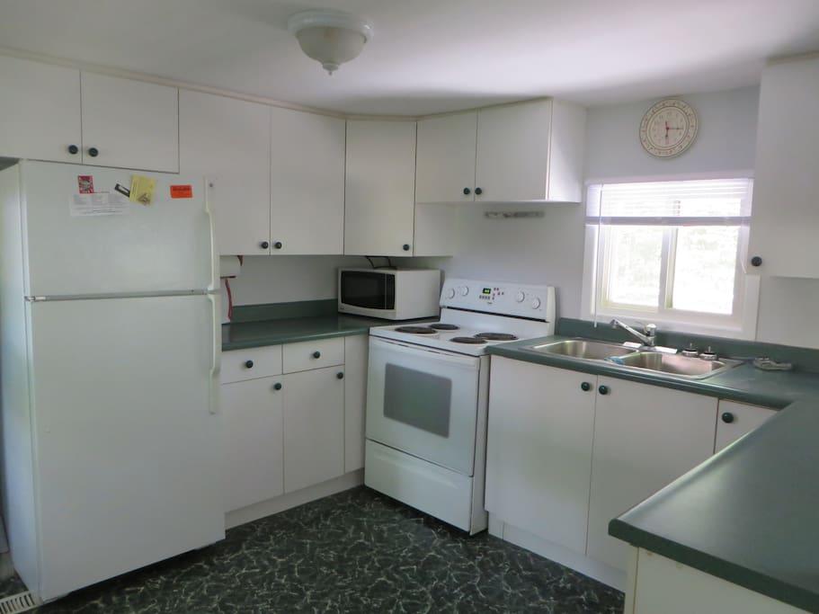 Full kitchen overlooking living area