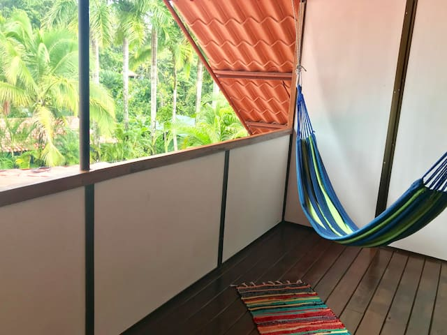 balcony of bedroom #3 (2nd floor) with treetop view!  good place to chill in the hammock and watch animals!