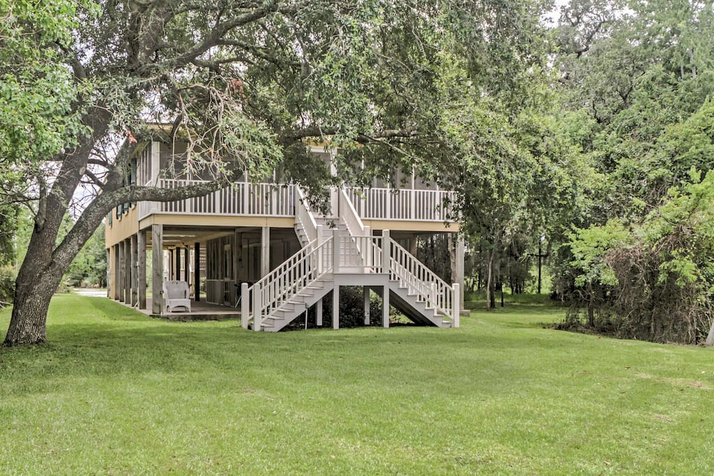 The home offers a pier, screened-in porch, and plenty of outdoor space to enjoy the scenic views.