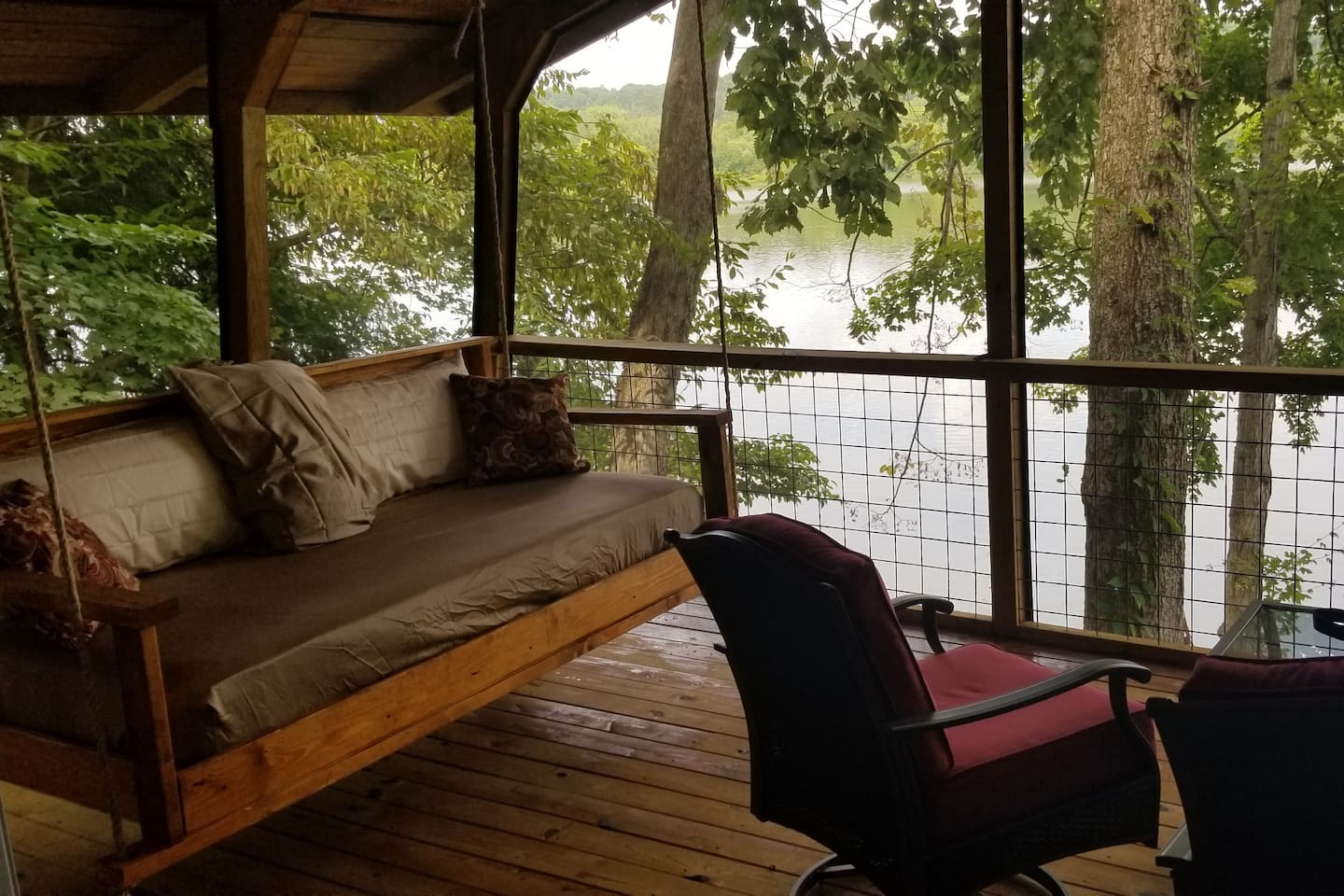 This swing bed is perfect for afternoon naps on the screened in porch, overlooking the water.