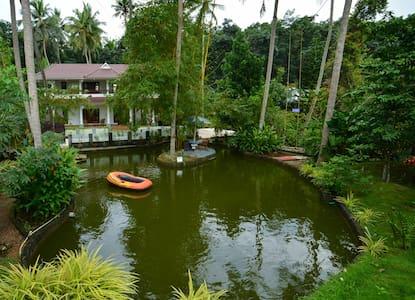 Amritham Holidays - Homestay