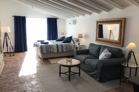 Studio apartment with two patios and pool