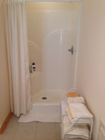 Private shower. With plenty of soft fluffy towels.  Soap, shampoo and conditioner and body wash.