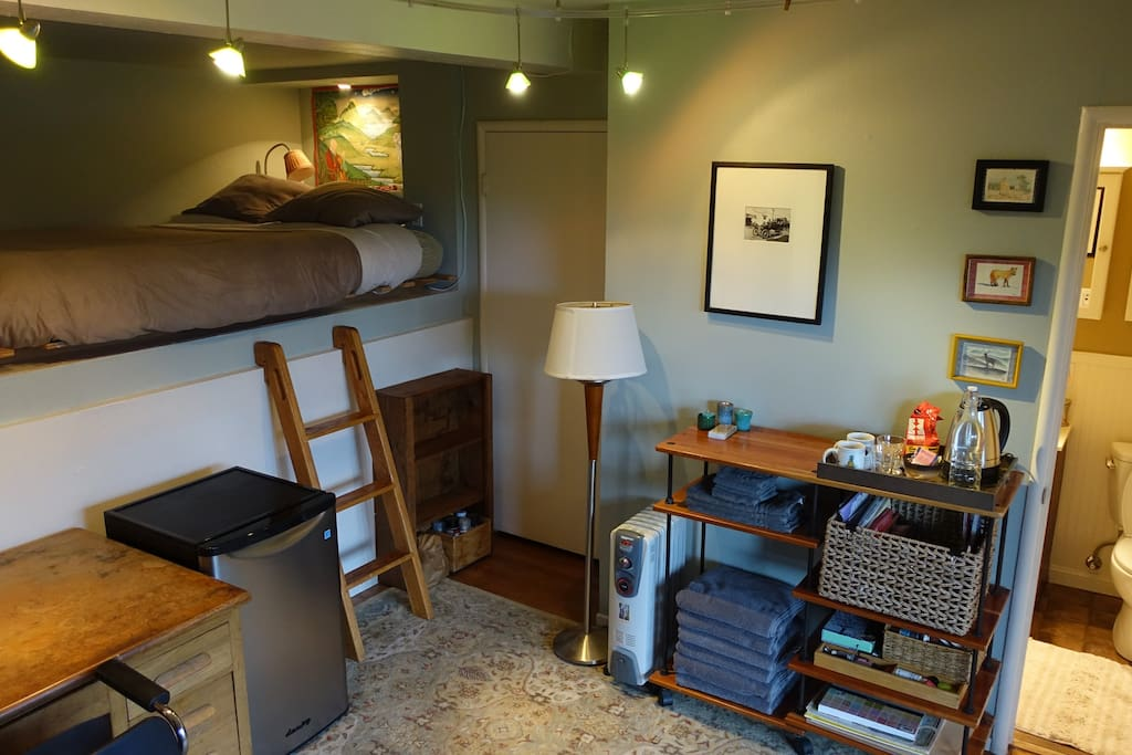 This is the room-- big desk for working, 3-steps up to very comfy queen loft futon, private full bathroom...