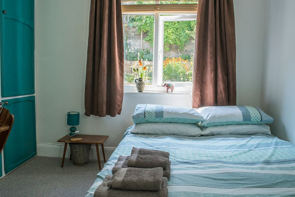 Bedroom with comfy kingsize bed & memory foam topper