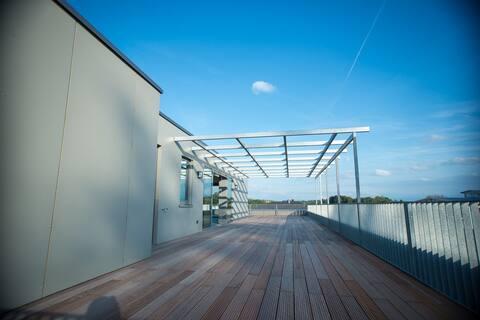 Designer Penthouse mit Dachterrasse und Bergsicht