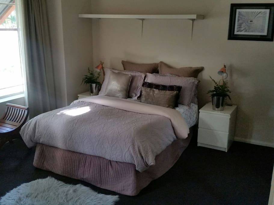 Double Bed with Mirrored wardrobe.