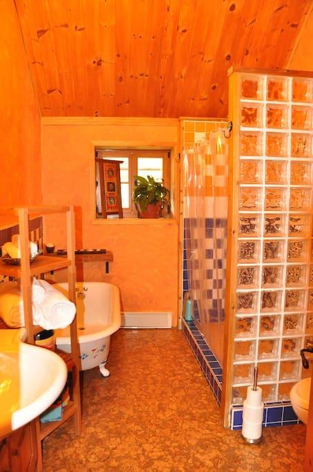 Main bathroom with full shower and claw bathtub.