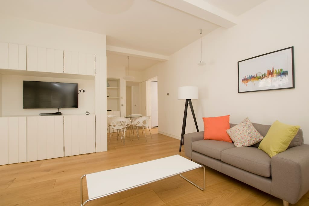 Comfortable Living-room with flat-screen TV and a work/dining table