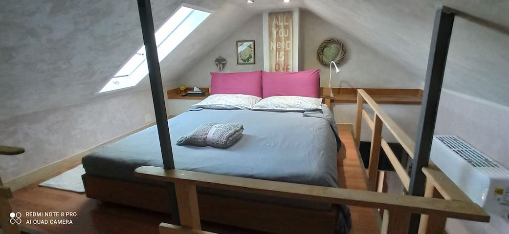 Loft bed with lake view