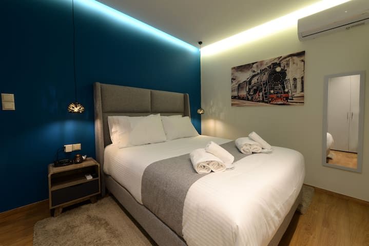 """The Bedroom.  Very comfortable bed by Candia strom collection (Mattress & Topper).  Fully Air-conditioned.  3 piece towel set per person by Cocomat.  Slippers provided for our guests.  Strong Wifi Internet Access. 32"""" TV with Netflix Access."""