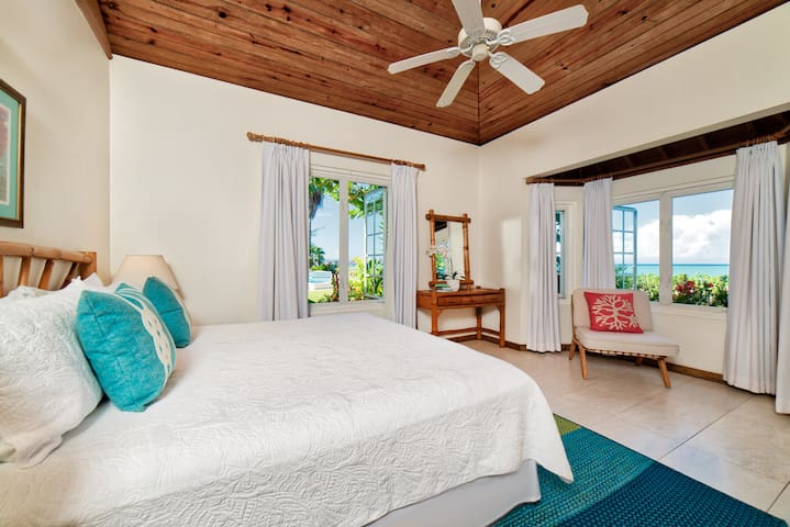 Bedroom #2      12x14 feet King bed, en suite bathroom, a/c, ceiling fan, bay windows, garden, pool, and turquoise Caribbean Sea views