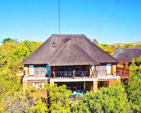 Aerial View of the lodge - privately situated, gorgeous views.  Upstairs: Patio, 1st-3rd private bedrooms with 2 1/2 bathrooms, lounge/kitchen/dining-room.  Downstairs: Patio, 4th private bedroom with bathroom, games room/overflow beds, shower toilet