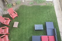 Cozy backyard for get-togethers or soccer games.  This is a shared space.